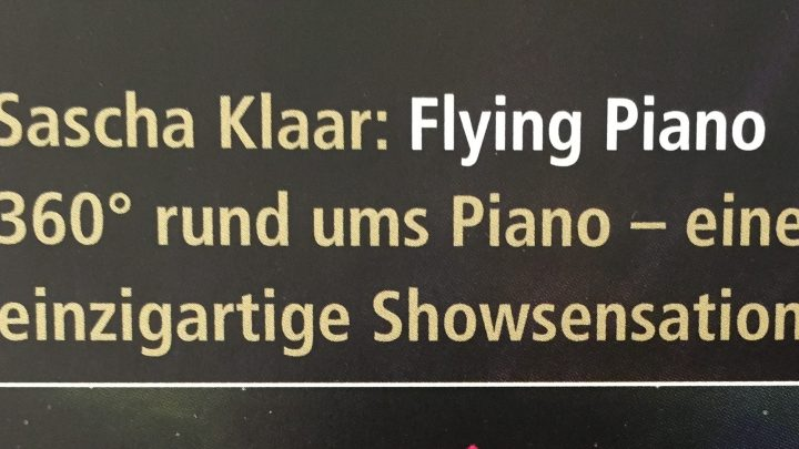 red flying piano